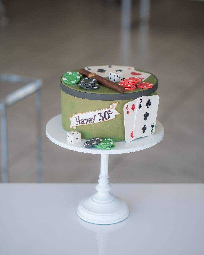 Birthday cake designed for the special man in your life. Decorated with playing cards and poker chips made with fondant. Order yours today at House of Clarendon in Lancaster, PA.