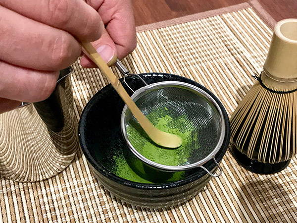 bamboo scoop to push matcha through sieve