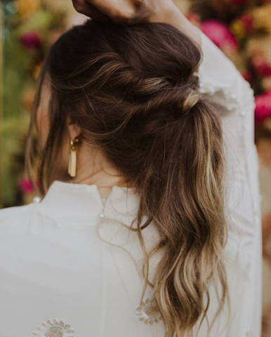 backview of a brunette woman with her long hair in an updo