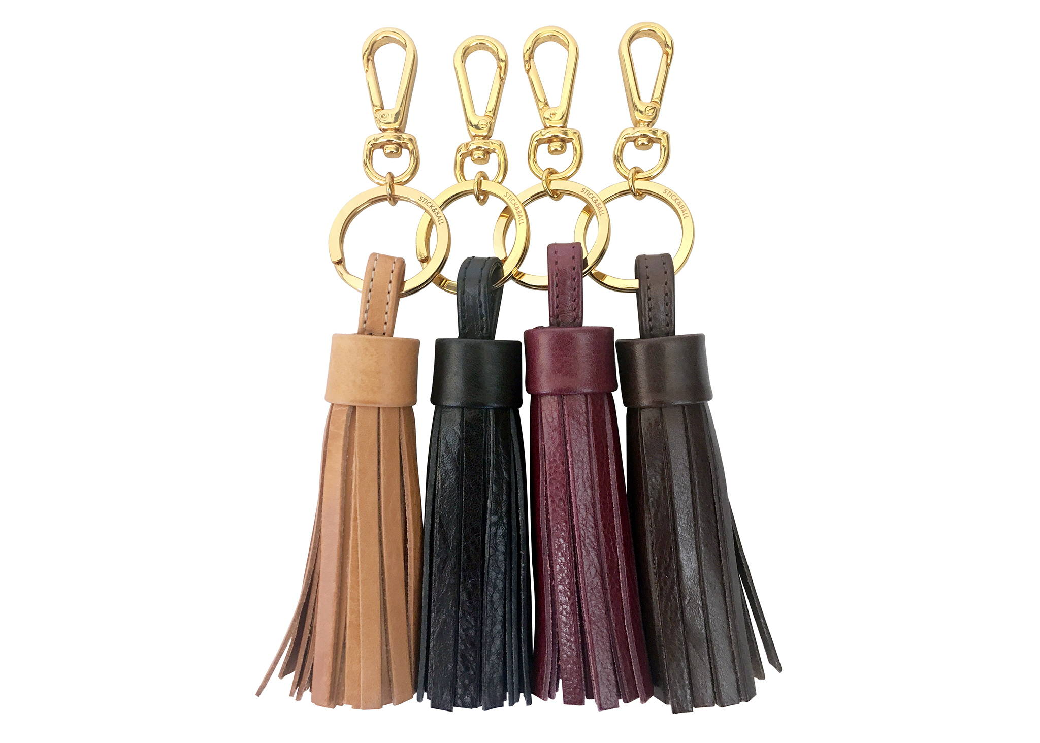Display of vegetable-tanned Italian leather tassel keychain in tan, black, burgundy & espresso brown - Stick & Ball