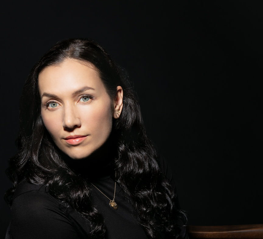 Headshot of Melissa Febos, leaning to the side.