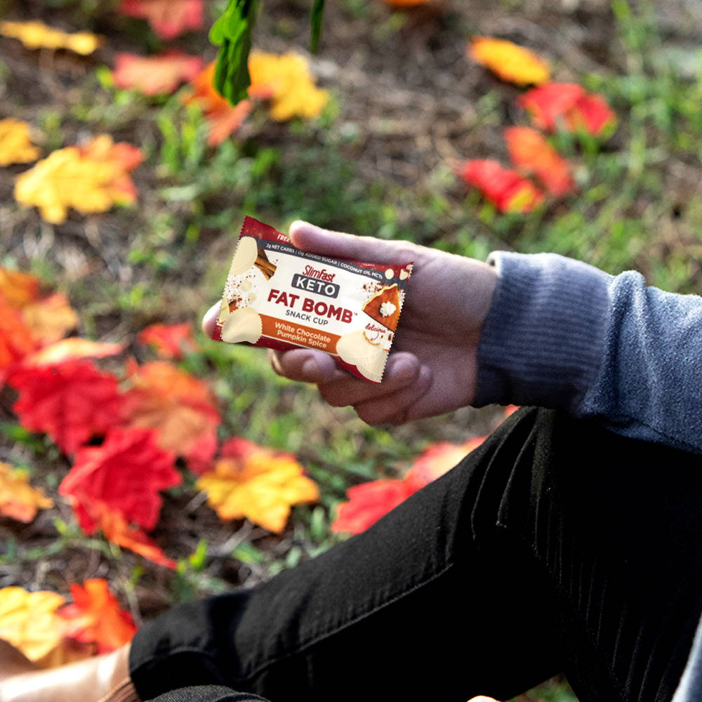 SlimFast Keto Fat Bomb White Chocolate Pumpkin Spice Snack Cup on the go, on a hike