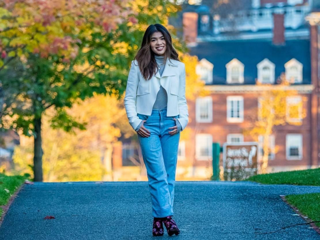 Farah Azmi founder IXORA apparel wearing white blazer