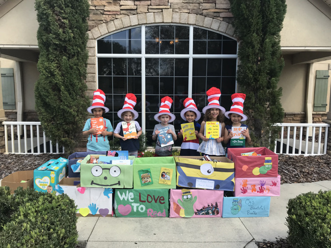 Kindergarten students posing with donated books