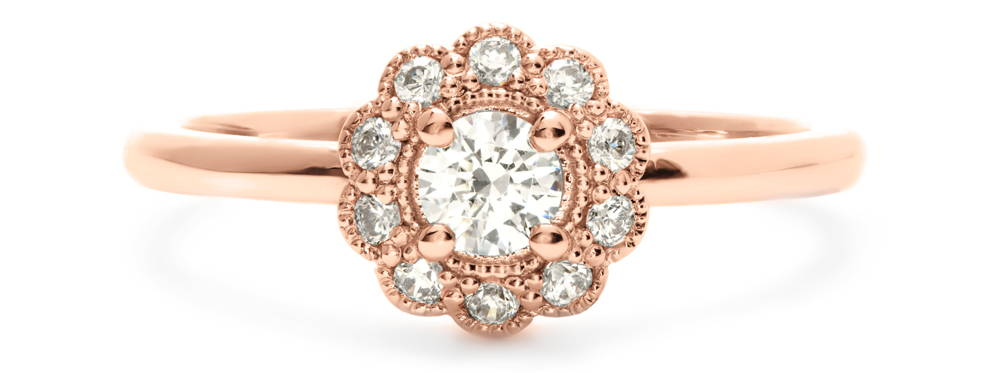 A pink gold ring of great delicacy for an engagement with a 4 mm laboratory-created diamond and encircled by a flower of 10 diamonds ...
