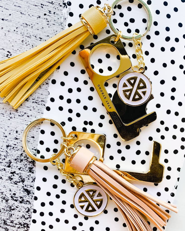 Blush and yellow no-touch keychain tools