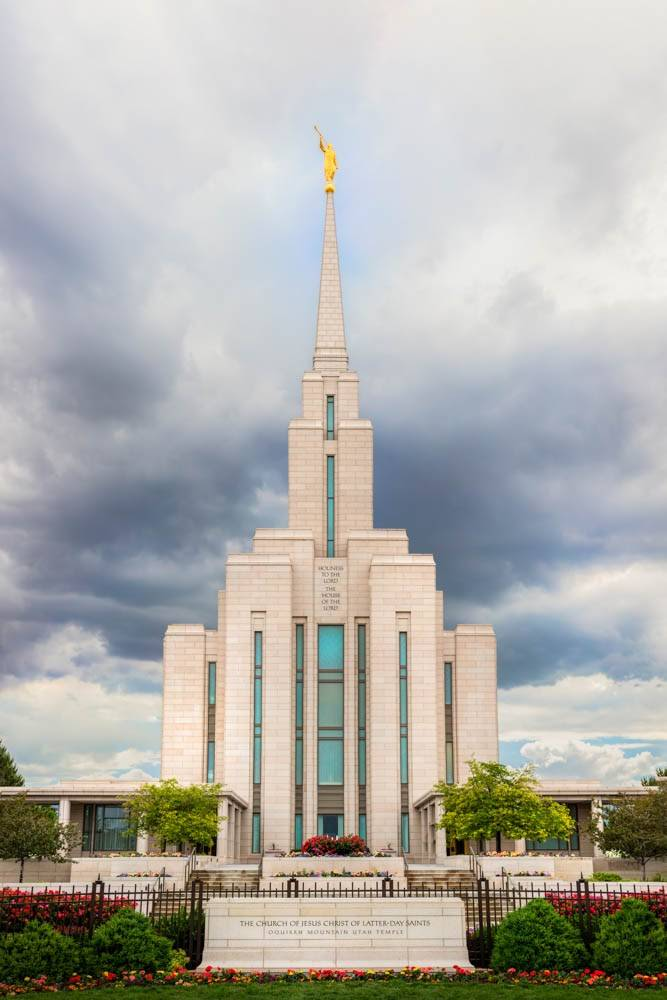 LDS art vertical photo of the Oquirrh Mountain Temple against a cloudy sky.