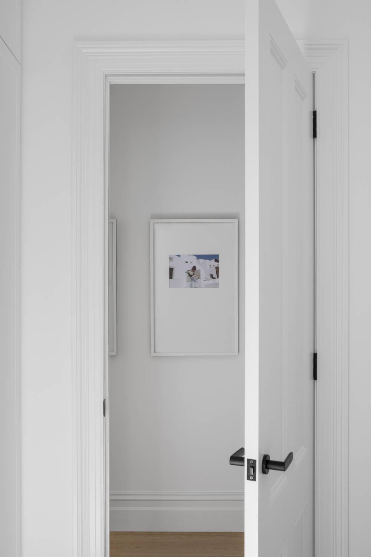 Framed wedding photo positioned outside a bedroom door