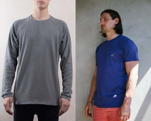 Man wearing grey organic cotton sweatshirt with black jeans and man wearing bamboo blue t-shirt with red shorts both from sustainable menswear brand Lyme Terrace
