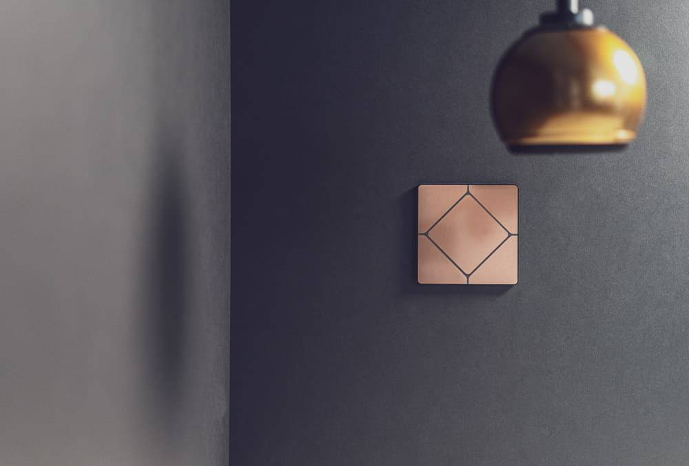 Faradite TAP 5 brushed copper home automation switch with a Gallo Speaker