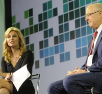 Beauty and the boss: CNBC's photogenic reporter, Mandy Drury, lends her branded presence to TD's event as she tosses some questions at CEO Fred Tomczyk