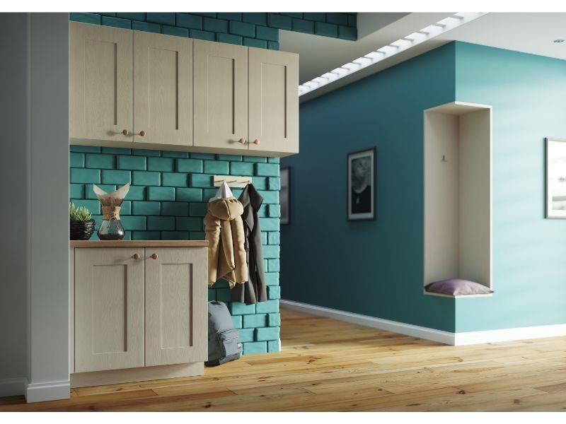shaker style cupboard doors in a blue open space kitchen
