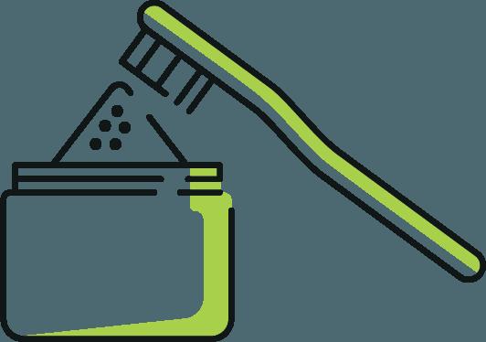 Trempez la brosse à dents dans le pot de poudre de charbon