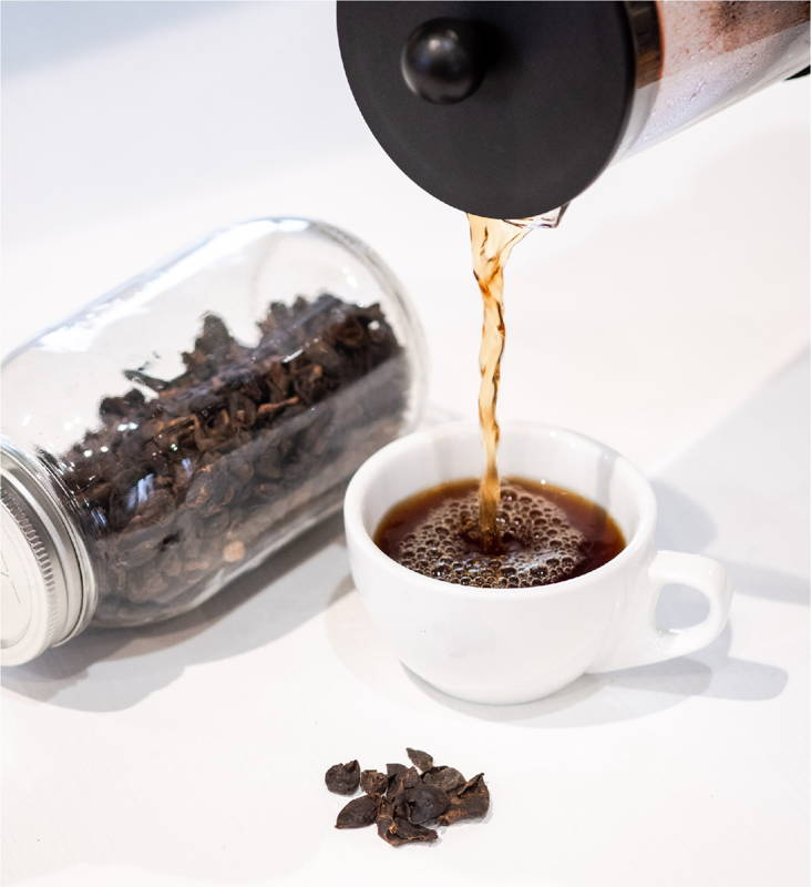 Cascara Hot Tea being Poured into Cup
