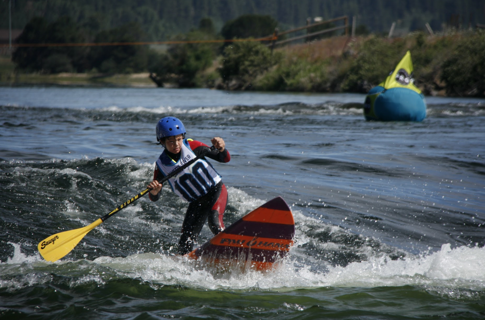 Kid paddling the sup carve surfboard by Pau Hana surf supply on the river