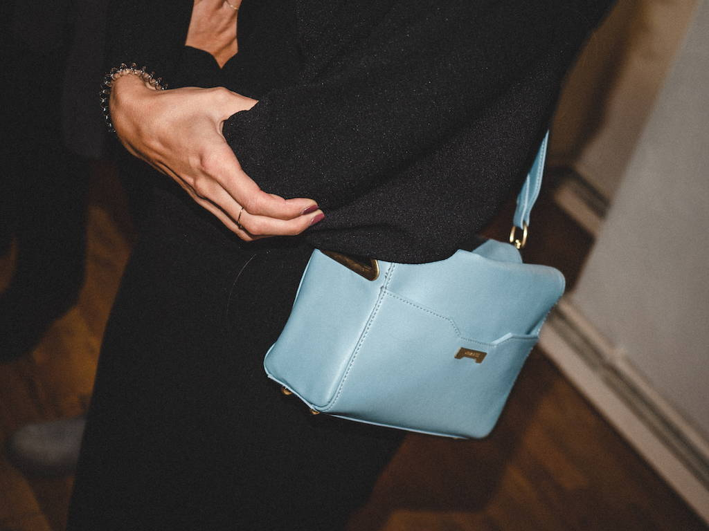 Light blue Vegan leather and ecofriendly pouch at the popup store in Berlin, Prenzlauerberg