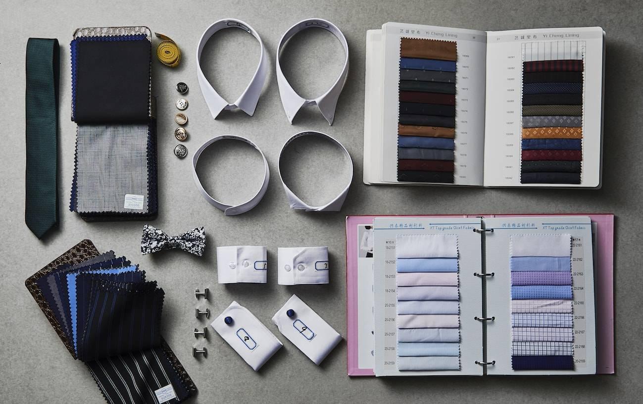 TailorMate   billede af set-op med stofbog, slips, jakkesæts accessories og meget mere.