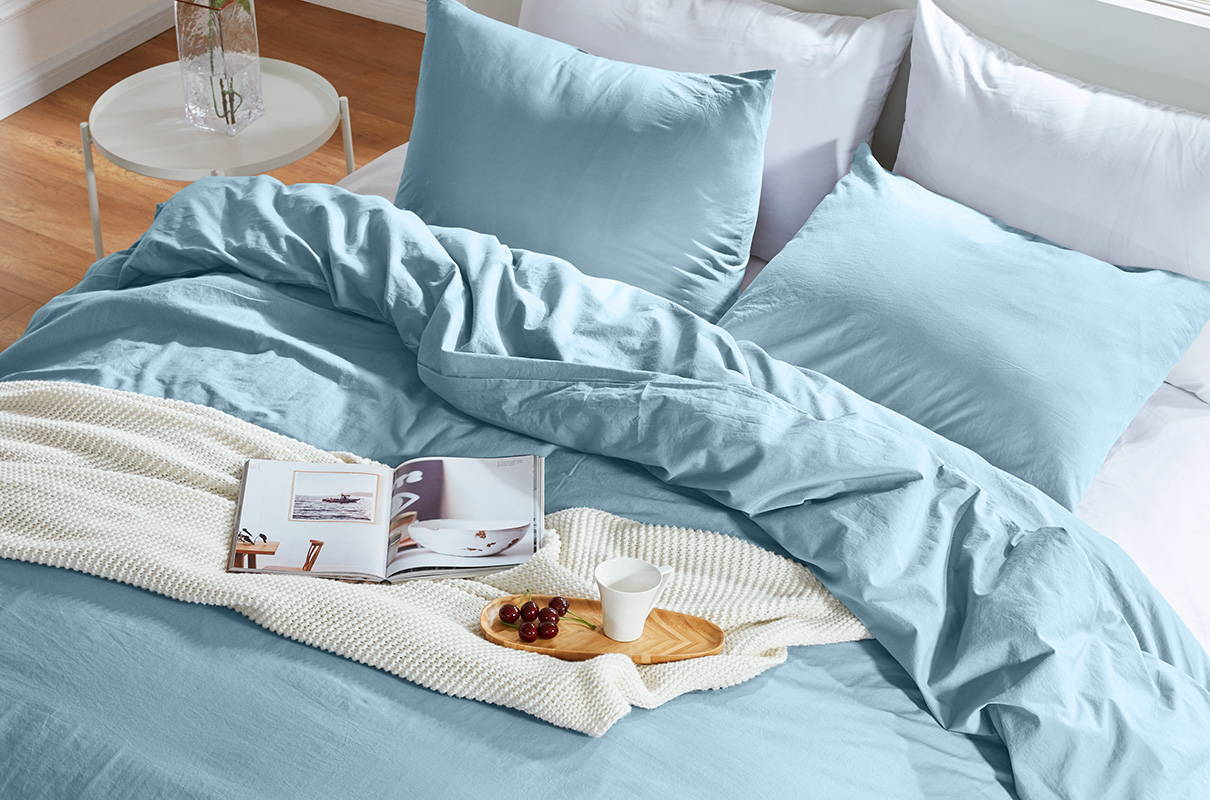 sleep zone bedding website store products collections cottonnest solid washed cotton duvet cover set blue read coffee on bed