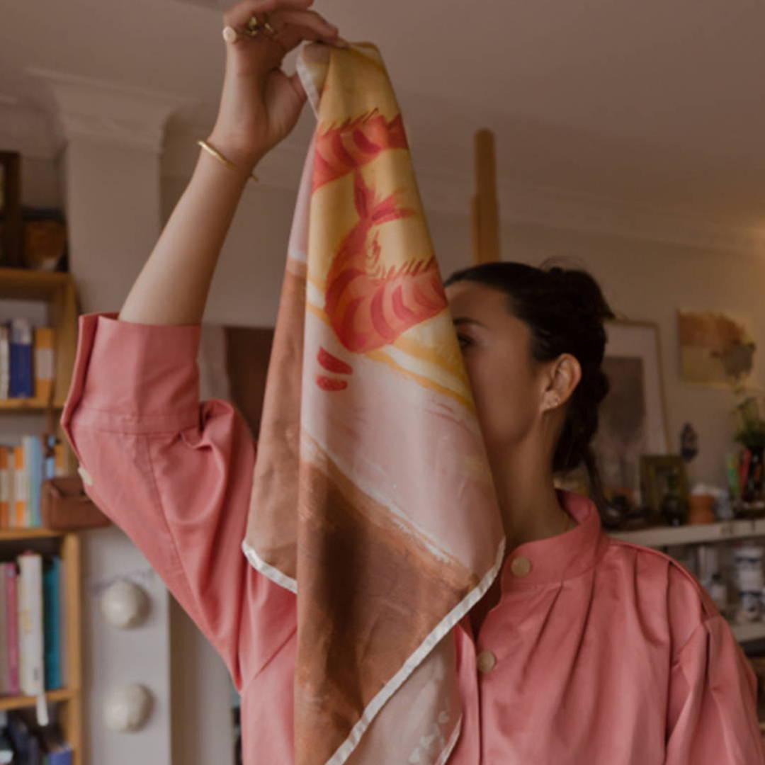 Lady holding scarf