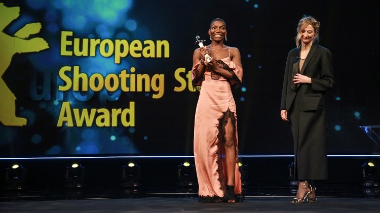 Michaela Coel standing on stage at the 2018 Shooting Stars ceremony