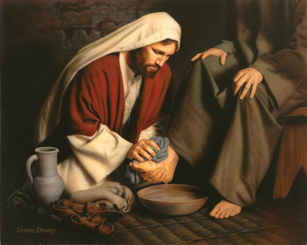 Painting of Jesus kneeling and washing one of the disciple's feet.