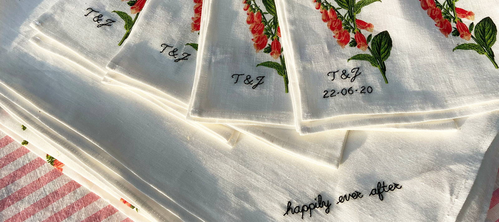 """YOLKE monogrammed foxglove table napkins, saying """"happily ever after"""""""