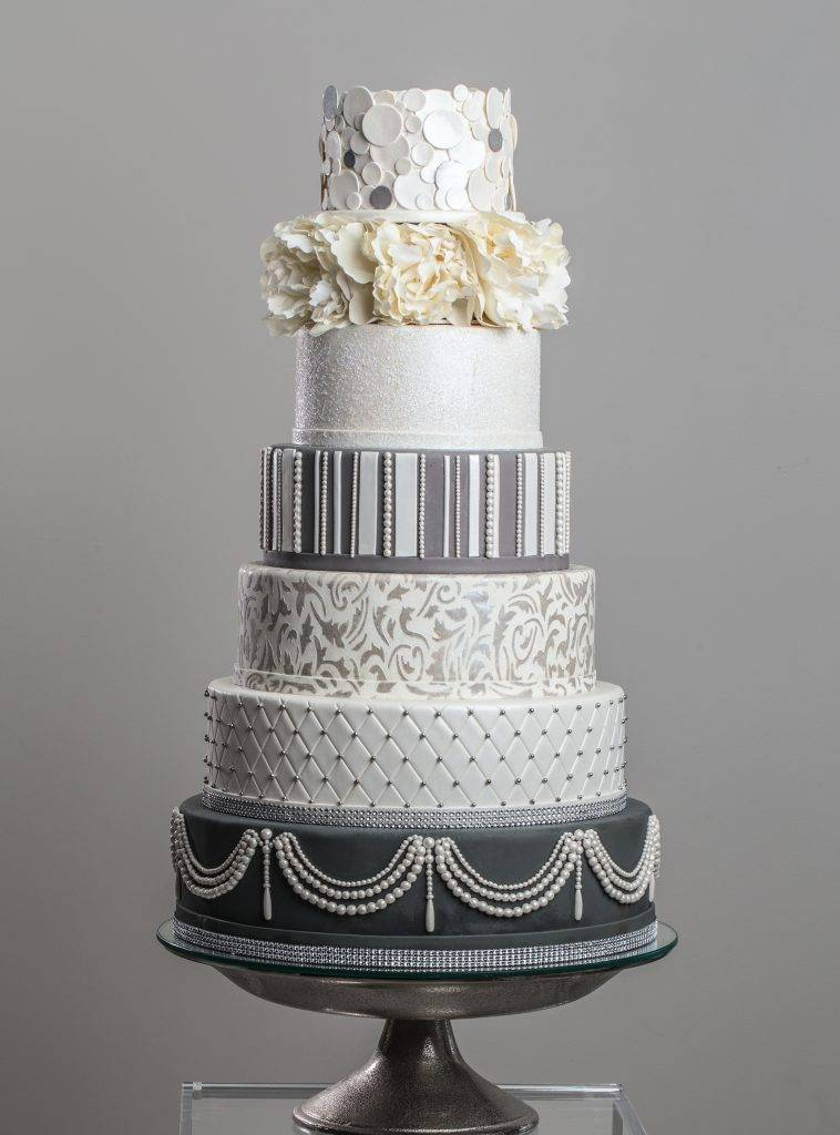 Luxurious and fabulous seven tiered wedding cake made by the team at House of Clarendon in Lancaster, PA