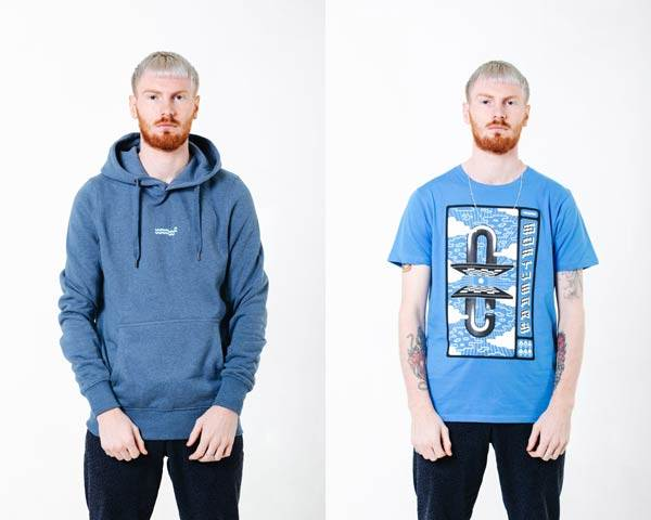 Man wearing washed out blue organic cotton hoodie with small Wawwa embroidered branding in the middle chest and man wearing organic cotton bright blue t-shirt with a space inspired pink, white and black graphic illustration both from sustainable fashion brand Wawwa