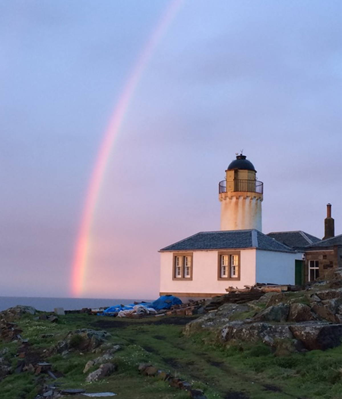 Lighthouse and raindow on The Bass Rock