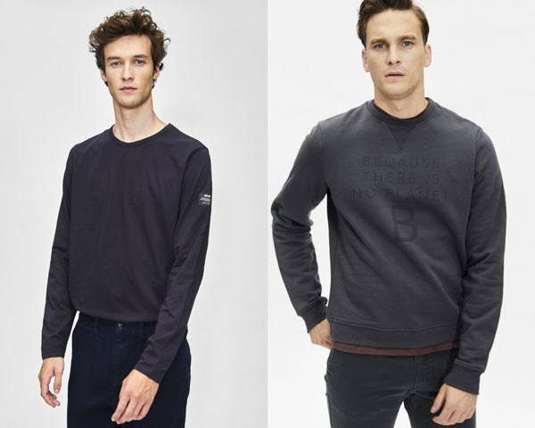 Man wearing blue navy organic cotton long sleeve t-shirt and man wearing dark grey organic cotton sweatshirt with slogan print