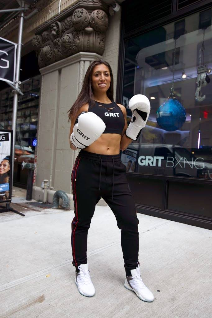 Ediva Zanker, wearing Vobyo boxing sneakers outside of GRIT BXNG