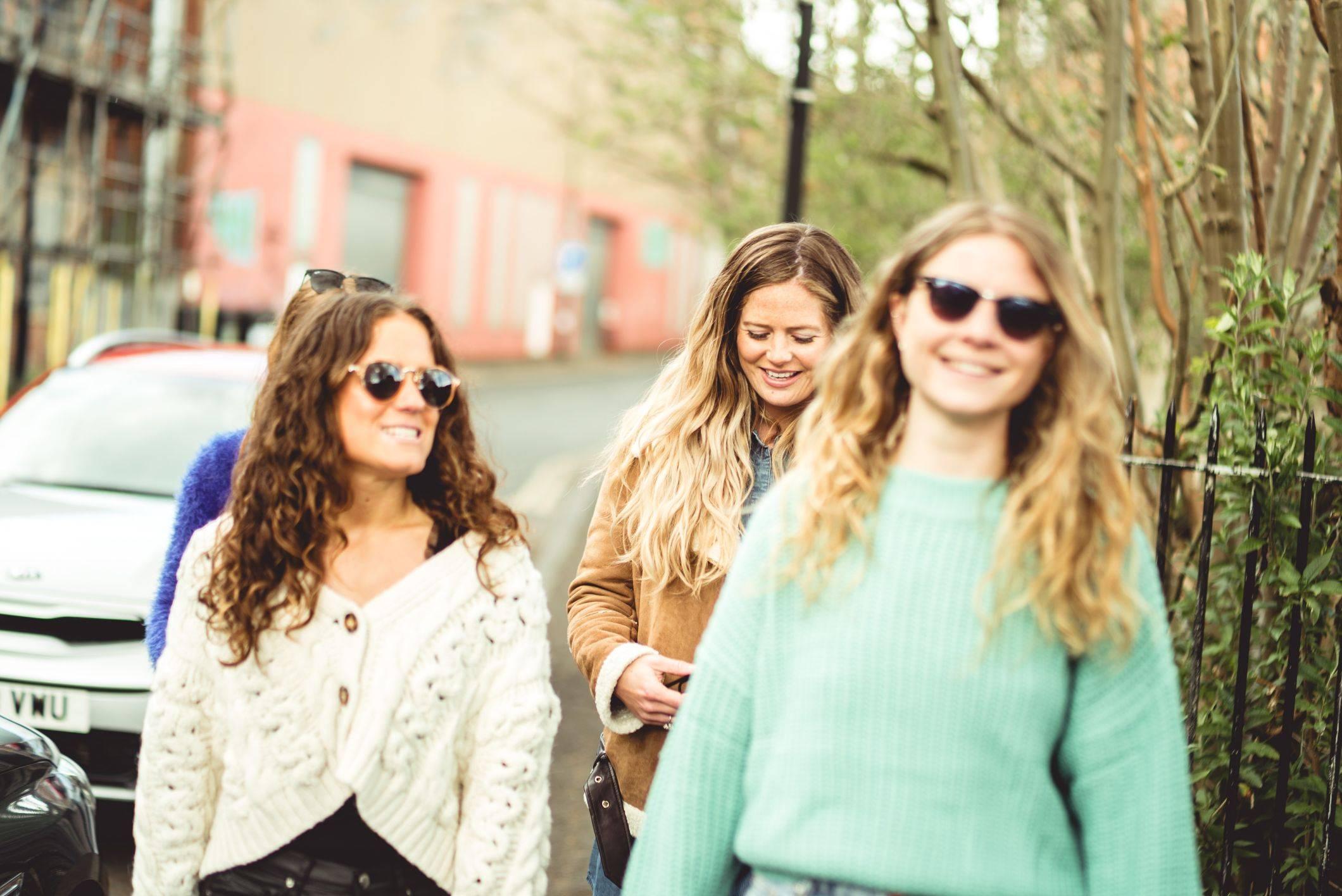 Image of girls walking down street
