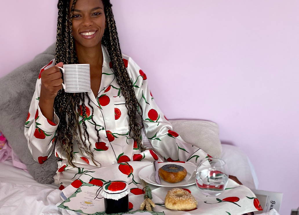 Noella Coursaris wears the Orange Print Classic Silk Pyjamas