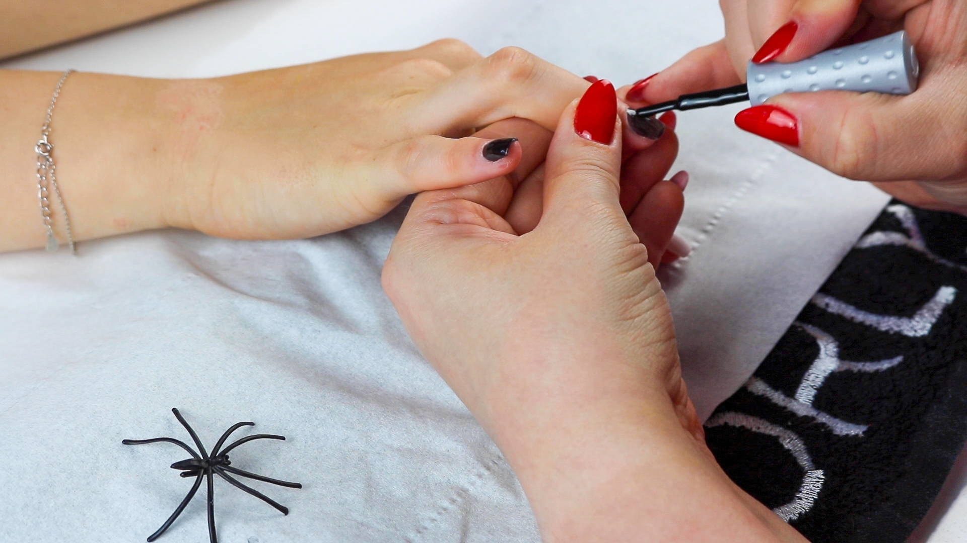 Jack Skellington nails being painted with ORLY Liquid Vinyl and ORLY White Tips