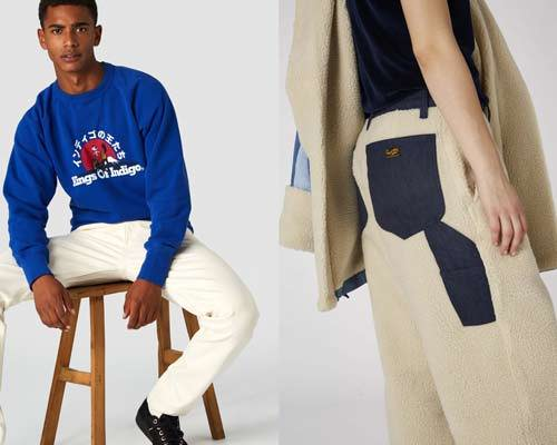 Man wearing Kings of Indigo organic cotton french navy sweatshirt with cream jeans and man wearing beige sherpa trousers