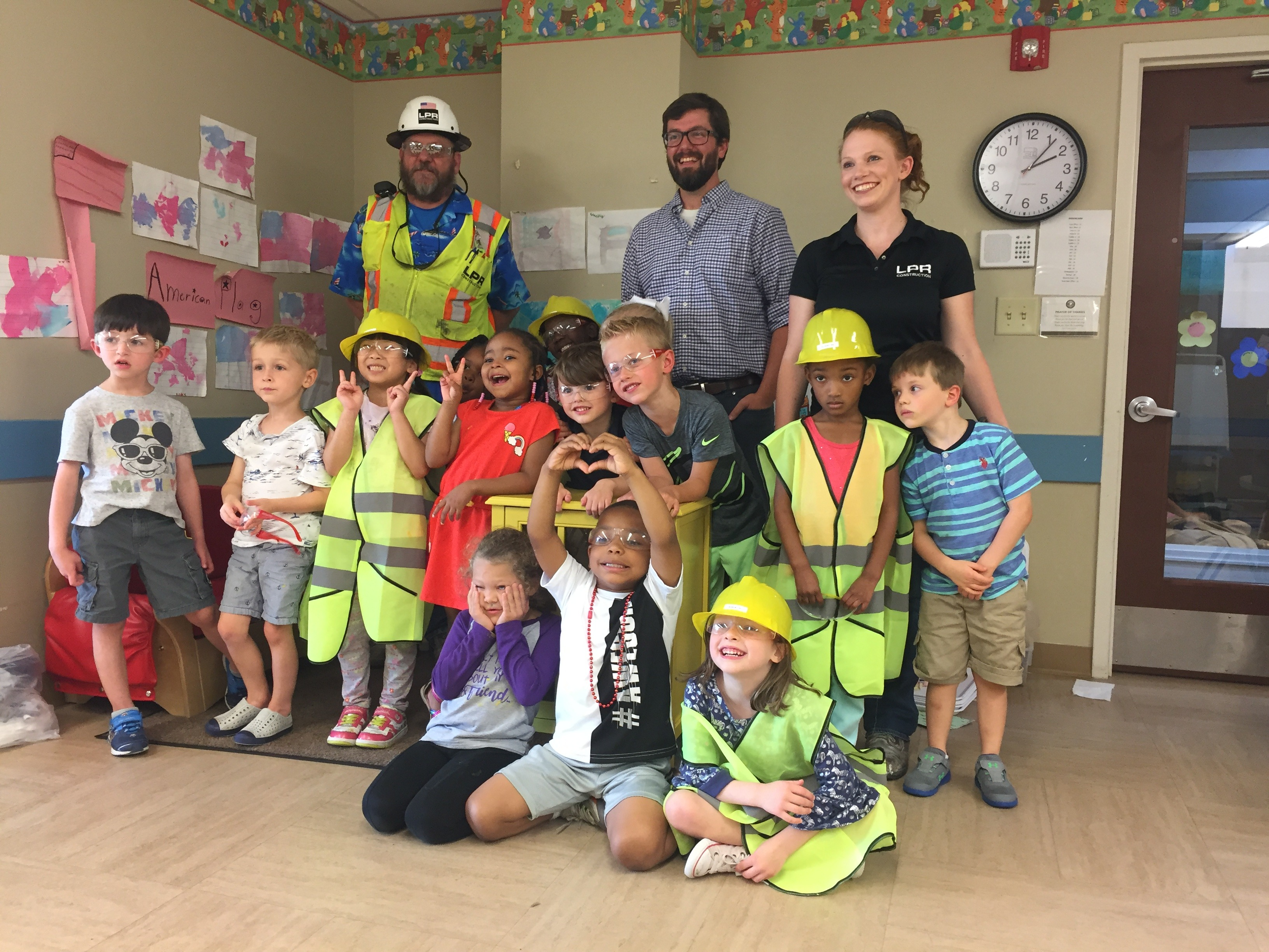 Group photo of children in hard hats