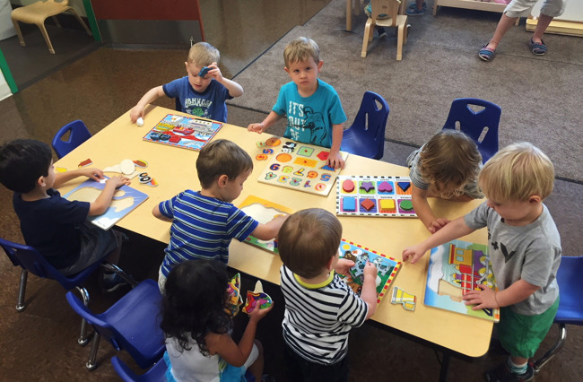 Young Primrose students play with different puzzles in the classroom