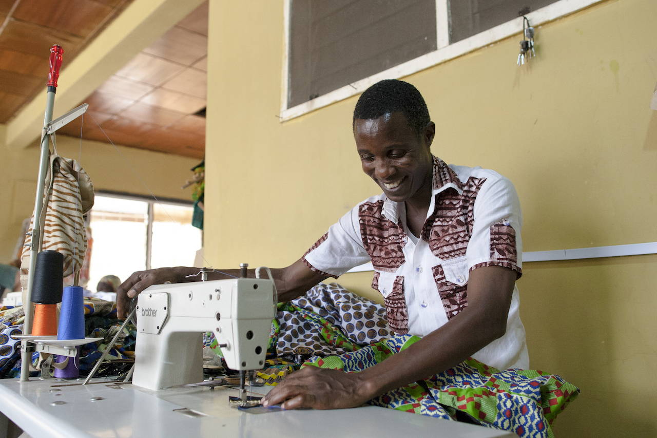 Stephen Z. Mensa is from Accra, Ghana. He has been working as a tailor for fifteen years and is supporting two children. He hopes to gain more training in tailoring and one day own his own boutique. He makes the Mens Jackets for YEVU.