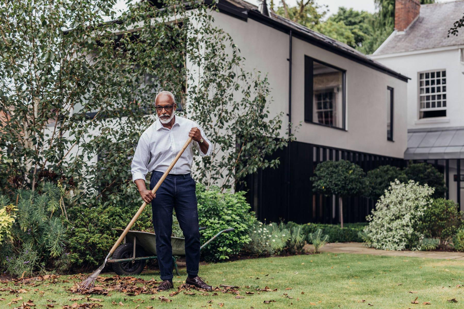 Man in shirt gardening