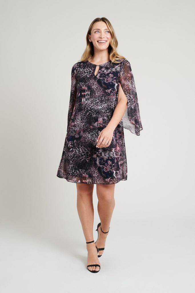 young woman wearing navy and purple floral and cheetah print connected apparel dress with chiffon sleeves