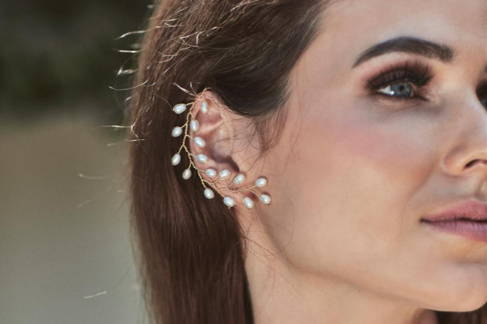 Close up view of the VINI ear cuff with  white freshwater rice pearls.