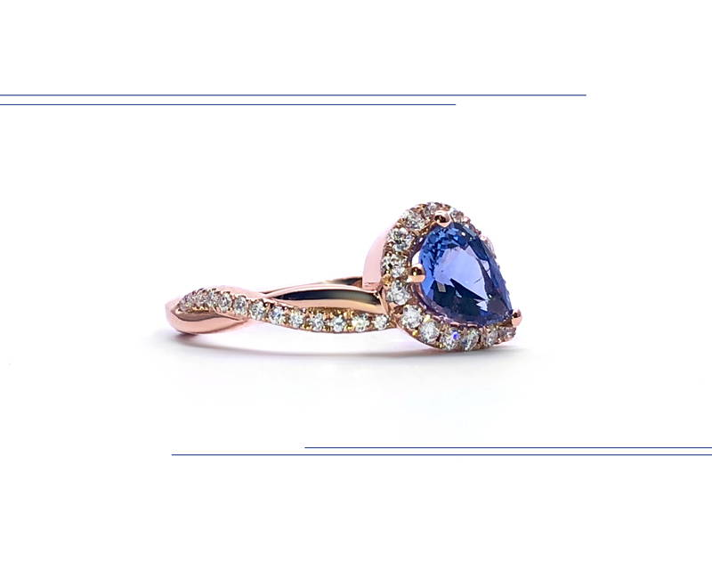 rose gold semi eternity ring with pear-shaped sapphire