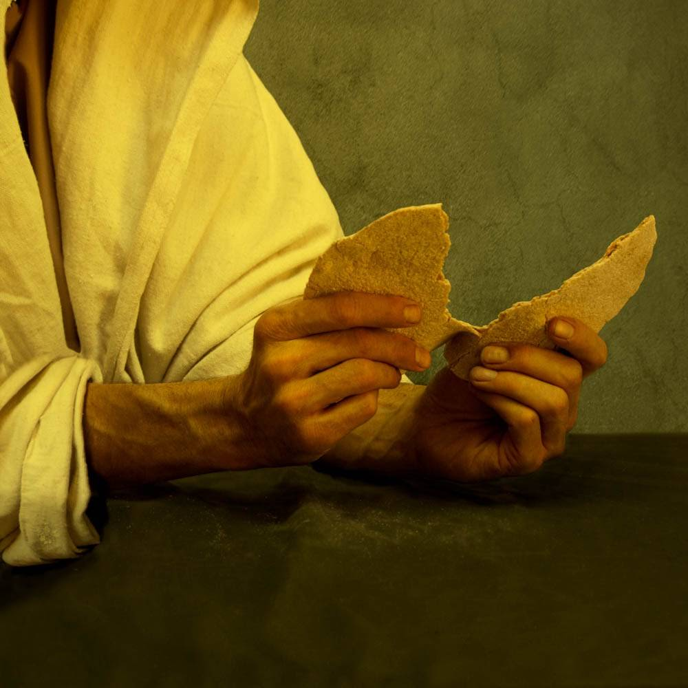 Photo of Jesus' hands breaking bread for the Last Supper.