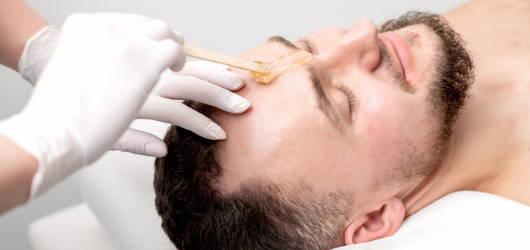 Man having eyebrows waxed