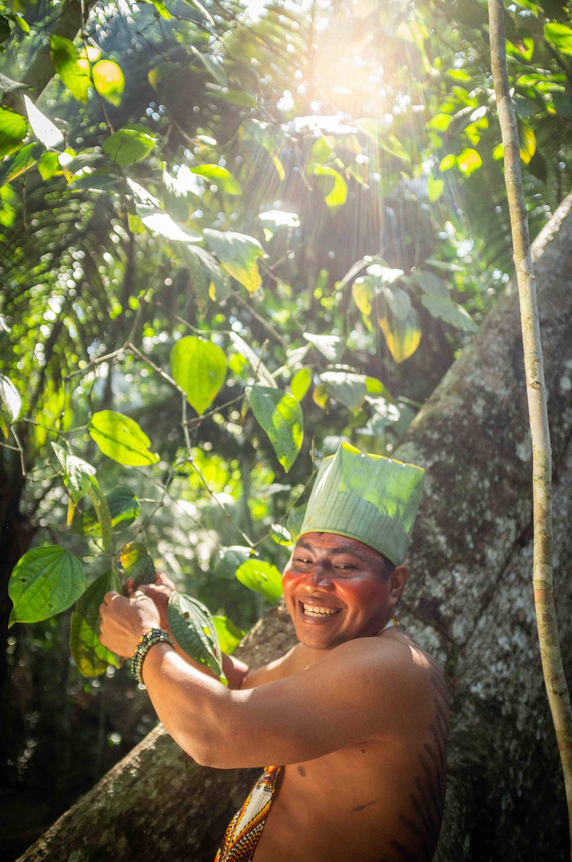 Yawanawá community member in the rainforest