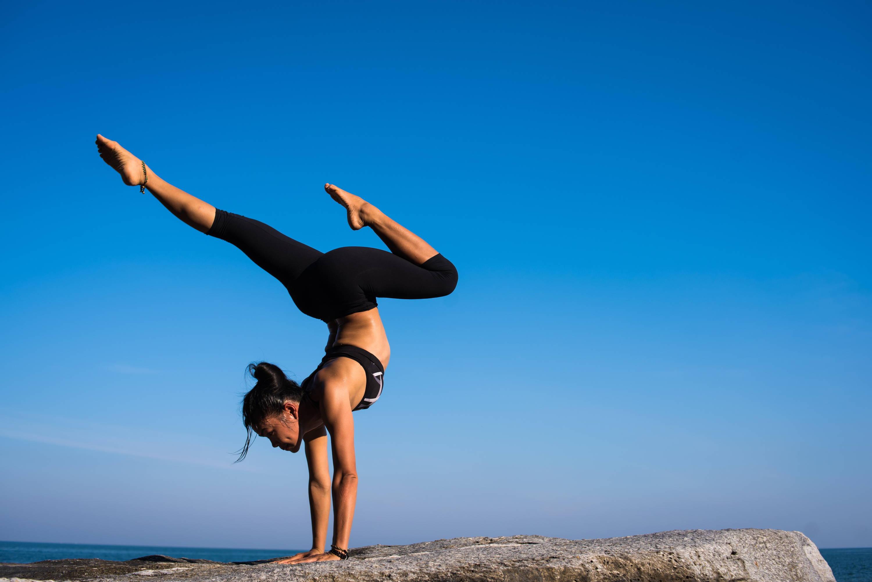 Women doing a handstand