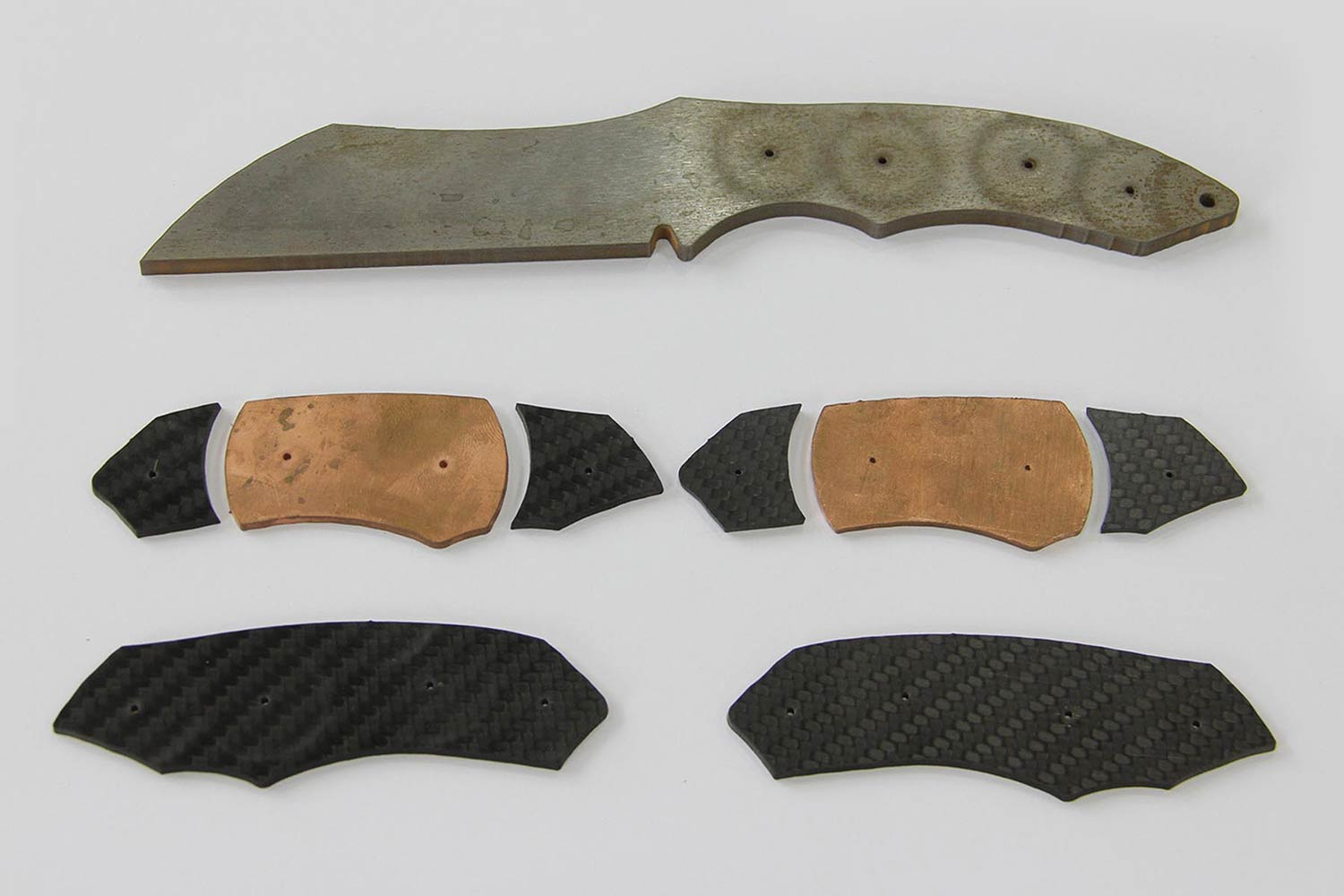 The knife was made from 4mm-thick D2 tool-steel and the handle from a combination of 2mm copper and carbon fiber sheets. In total the project involved 1 hour 58 minutes of cut time on WAZER a consumed 39 pounds (18kg) of abrasive.