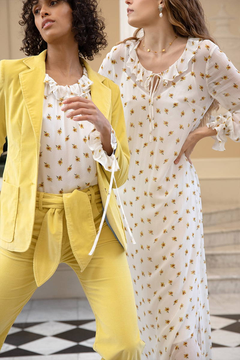 Close up of sunshine yellow corduroy bow Jeans and Hilary jacket, paired with the silk primrose print Stevie Blouse