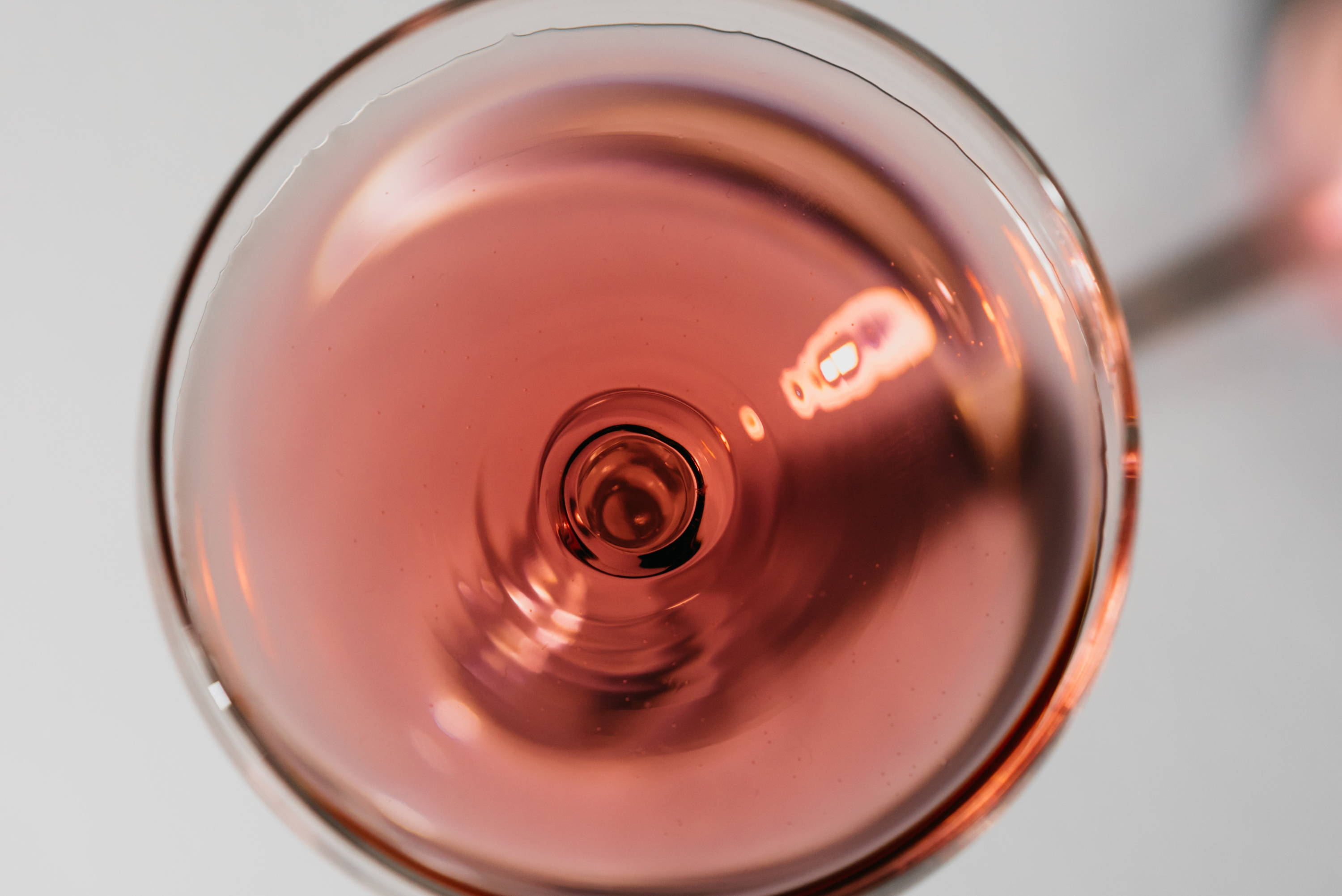 Top view inside rose glass staying true to its heritage; light red in colour and crisp.