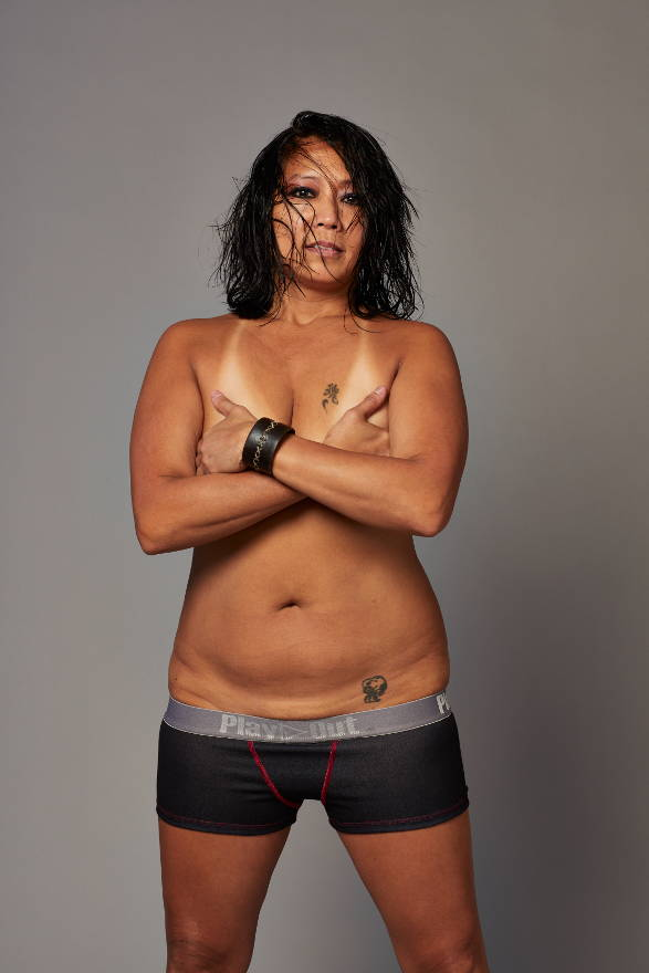 Model wears Play Out Zoe Bean low rise boxer briefs in zoe bean skeleton hand black design